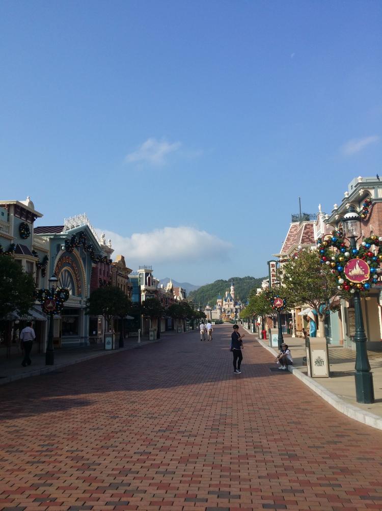Empty street leading towards Sleeping Beauty Castle.