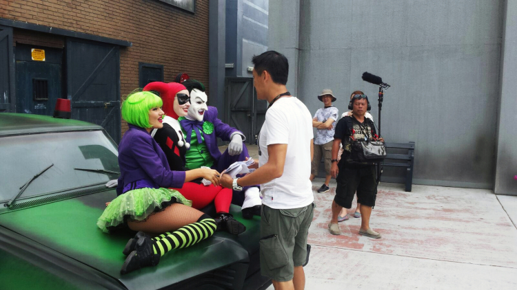 Director speaking to the three villains: Green-haired female villain (Don't know who she is), Harley Quinn and The Joker.