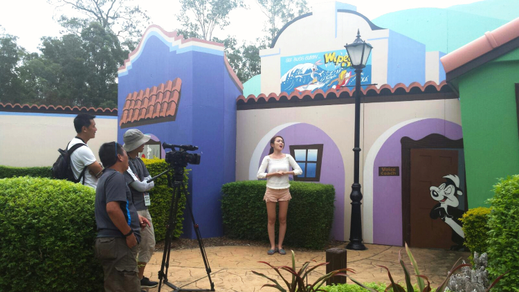 "Crew shooting me ""singing"" in front of an adorable house."