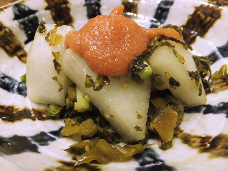 Radish and preserved vegetables dish topped with mentaiko.