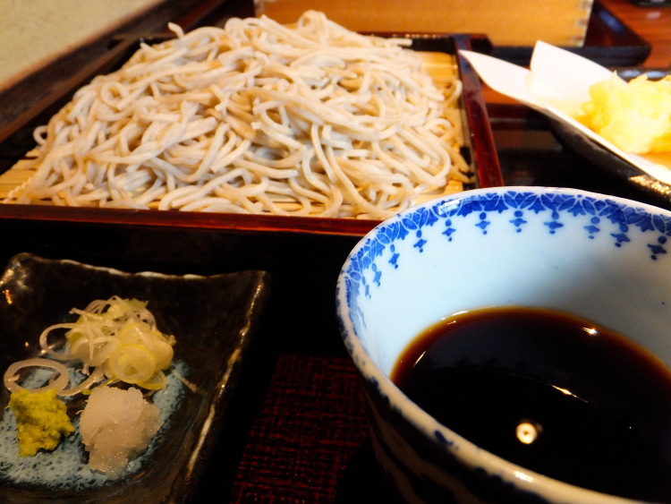 Soba set with dipping sauce, tempura  and other condiments.