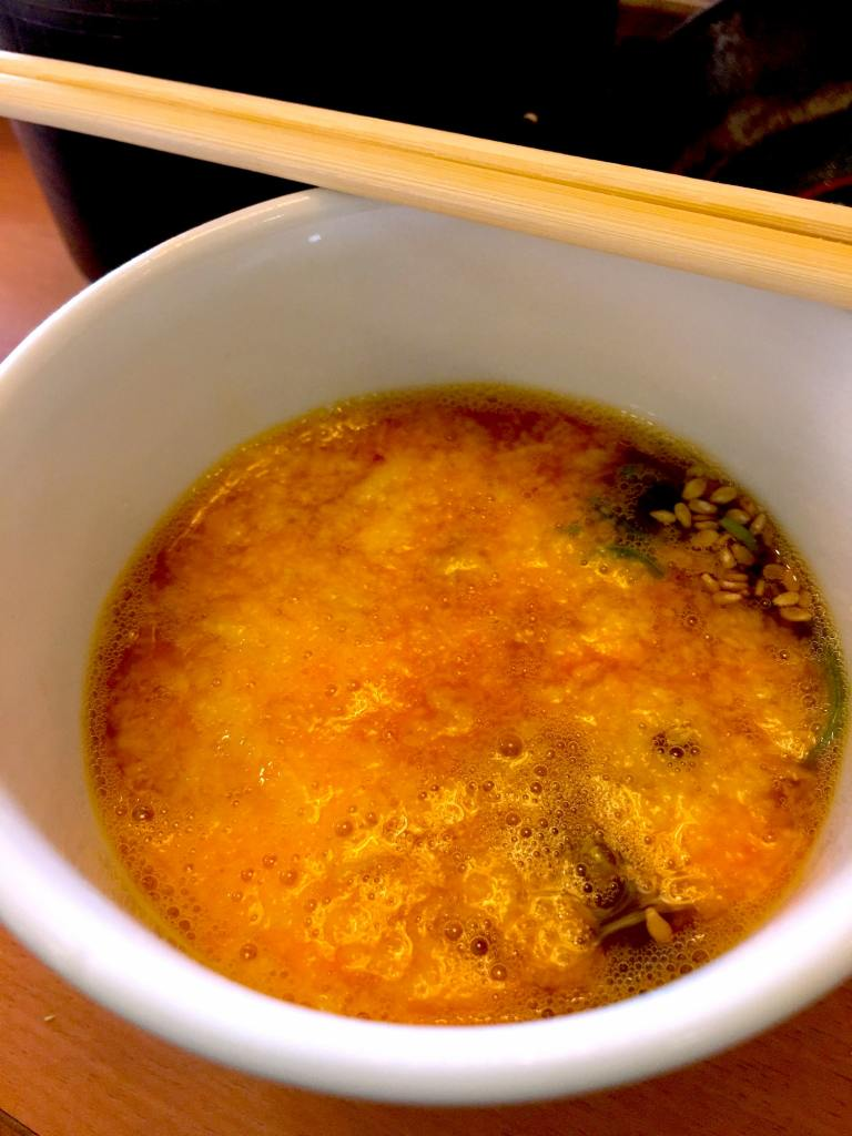 Dipping sauce mixed with spring onion, sesame seeds, tororo yam and egg yolk.