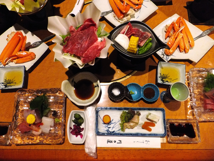 Dinner at the ryokan with sashimi, hot pot, Tajima beef and snow crab legs.