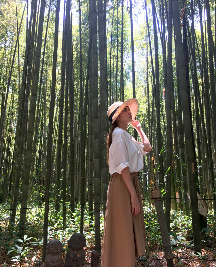 Me holding my star hat and looking skywards in the bamboo forest.