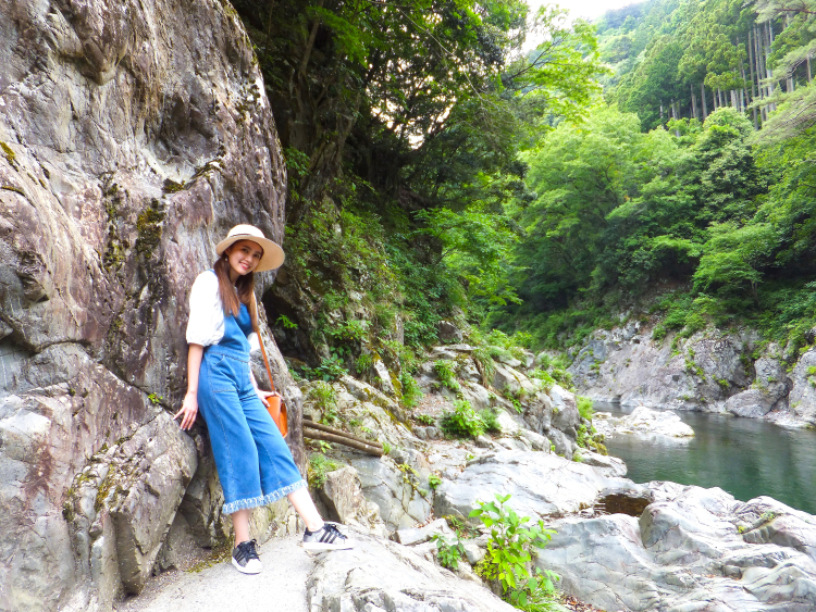 Me posing against a large crag along the river bank.