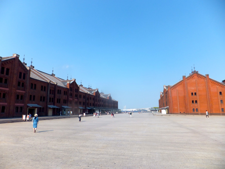 Plaza between the red brick warehouses.