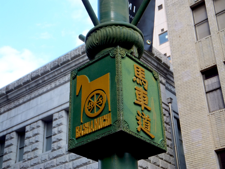 Close-up of a green European-style lamp with gold embellishments in Bashamichi Shopping Avenue.