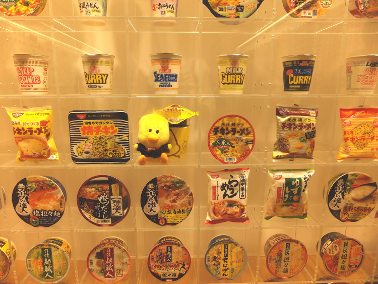 Close up of glass display of cup noodles in Japan.