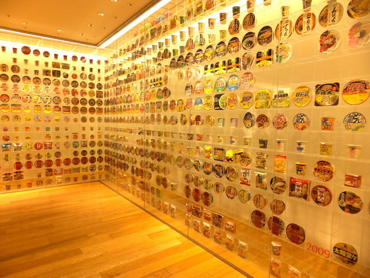 Glass display of cup noodles from around the world.