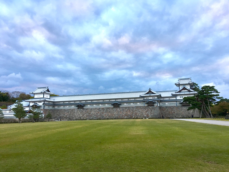 A large green space before Kanazawa Castle.