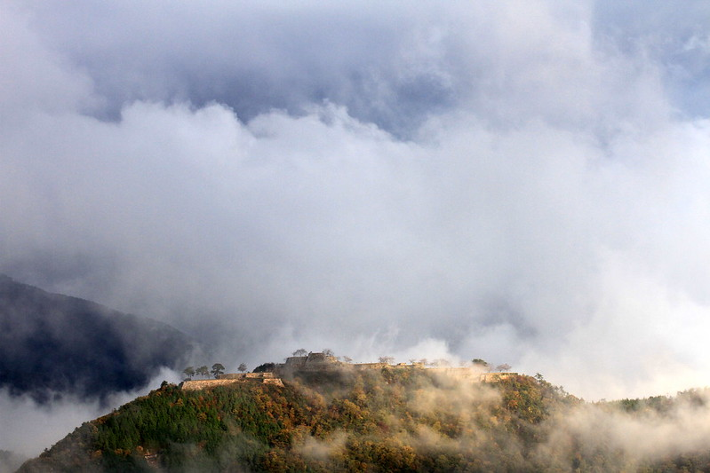 Takeda castle from afar enveloped in a sea of clouds.