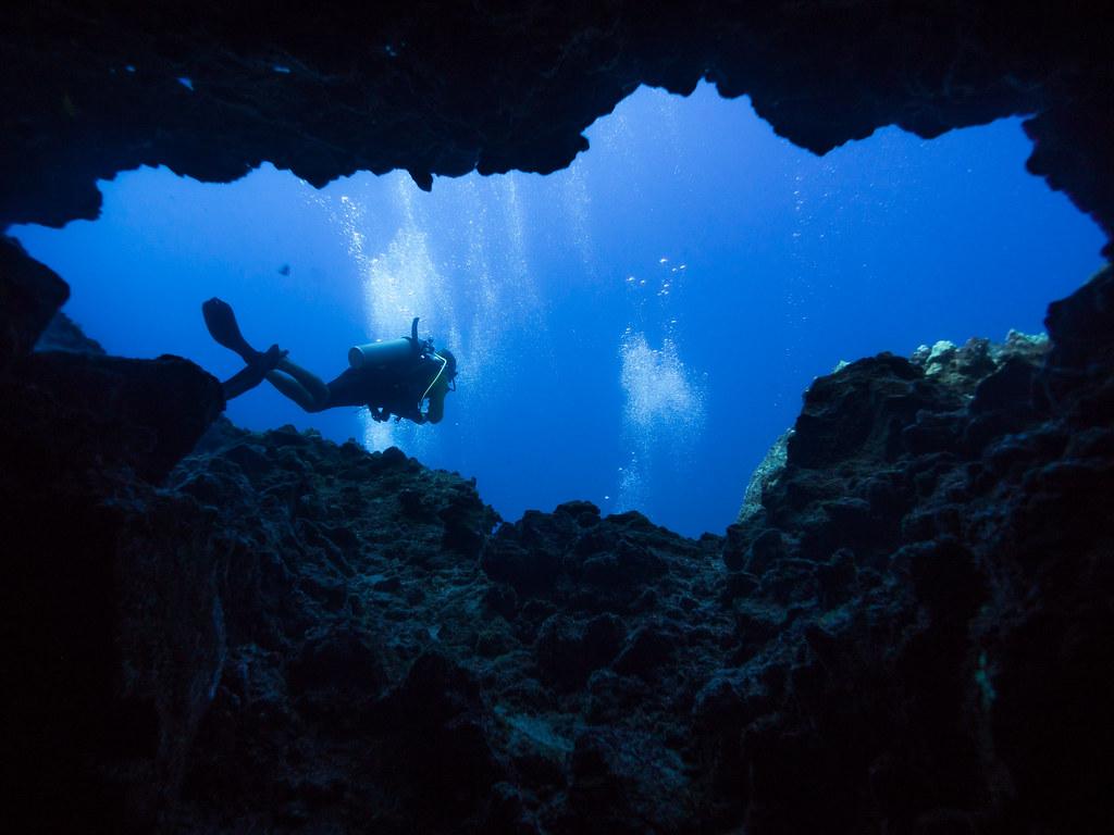 Diver in underwater cave.