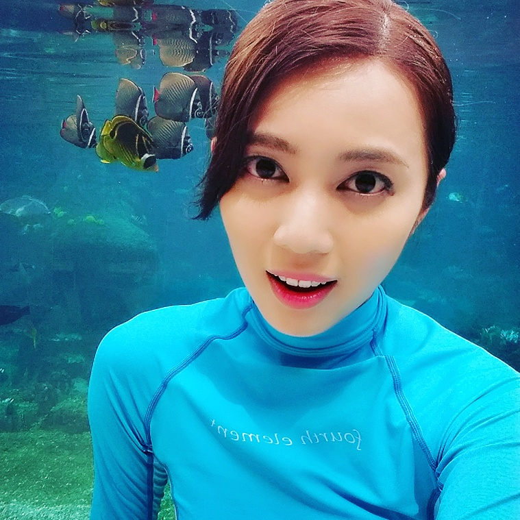 Me posing in front of fishes in Rainbow Reef.