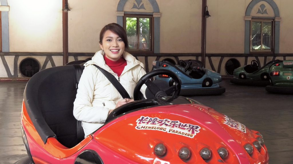 Me sitting happily in a red bumper car.