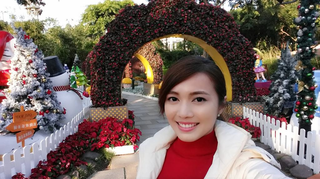 Me in front of a Christmas garden within Chimelong Paradise theme park.