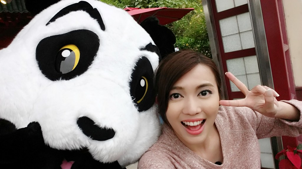 Me taking selfie with a panda mascot.