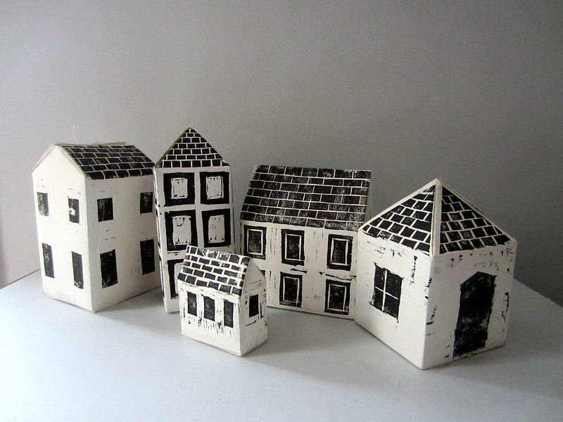 Paper houses painted in black and white.